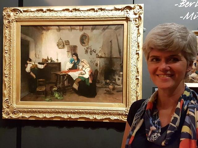 Melanie Czapski, Bucks County Museum Curator of Art, with 'A Scene from the Risorgimento' by Italian artist Gerolamo Induno.