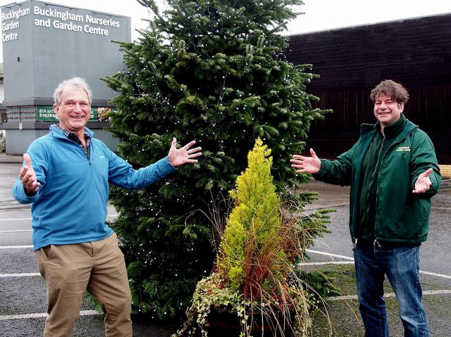 Geoffrey Furber, Founder, Ripple Africa together with Peter Brown, one of the partners of Buckingham Garden Centre, celebrate this month's successful fundraising efforts under the Christmas tree.