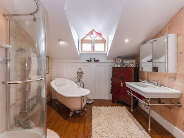 The master bedroom is fitted with a dressing area and luxurious four piece bathroom.