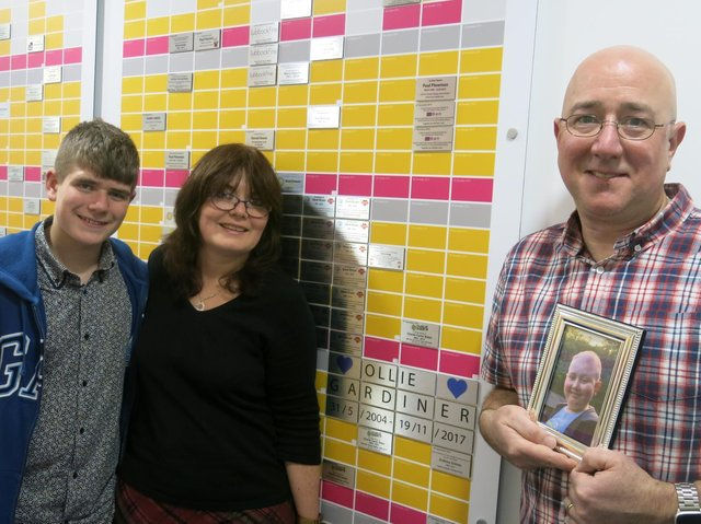 Theo, Jane and Peter Gardiner at Wall of Hope at Queen Mary Univ of London.