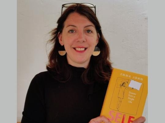 Emma with her new book, Self Contained