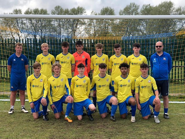 Under 18s at their last home match. Manager Adrian Green has been with them since the start.