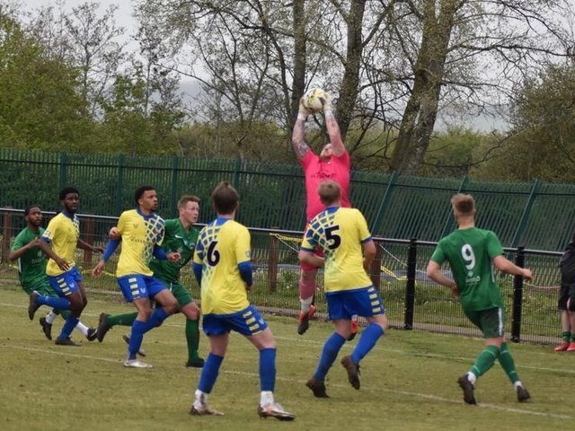Goalkeeper Dan McAteer collects the ball for Aylesbury Vale Dynamos against Newport Pagnell (Picture by Iain Willcocks)