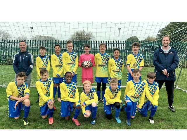 The Under 13s Dynamos with coach Woody (right)