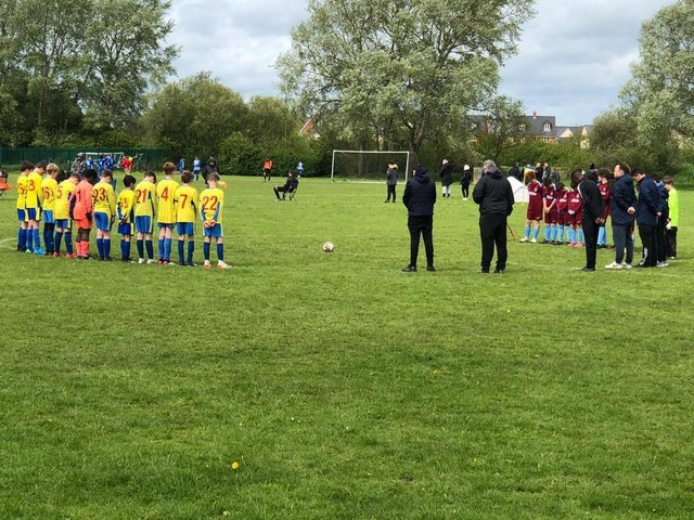 The Under 11s Youth in a minute's silence for vice-chairman Steve MacDonald before their game at the weekend
