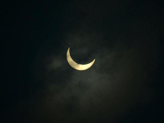 The moon partially covers the sun during an annular solar eclipse in June 2020. (Photo: Diptendu DUTTA / AFP)