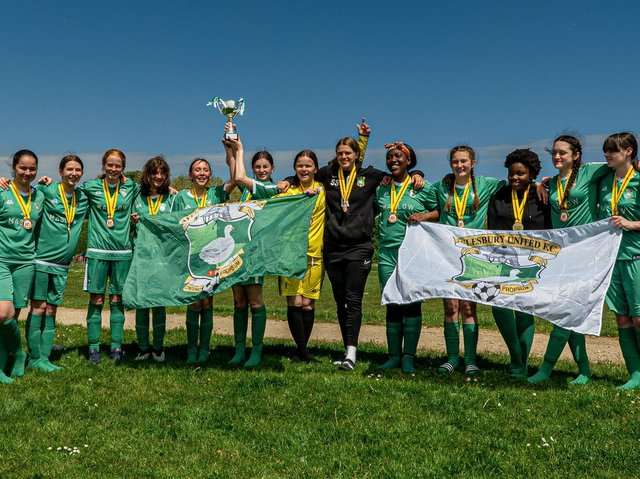 Aylesbury United Girls Under 14s Greens celebrate with their medals and  Division 2 trophy