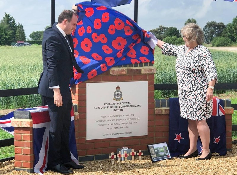 Greg Smith MP unveils the memorial assisted by Lynn Taylor-Overend, daughter of RAF Wing serviceman Eric Taylor,