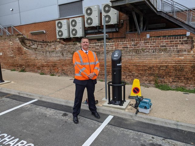 Cllr. Steven Broadbent, Cabinet Member for Transport, next to one of the new EV charging points