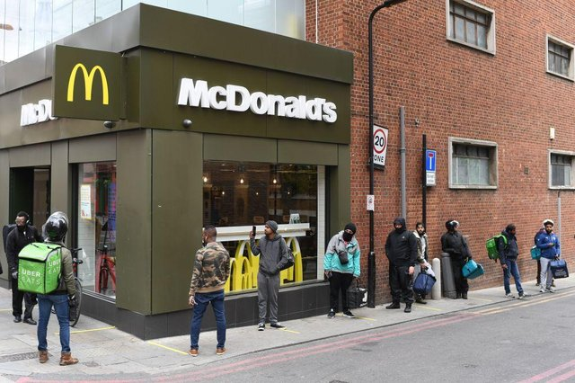 Delivery riders queue up outside a McDonald's restaurant in east London after the restaurant opened for delivery only orders (Photo: DANIEL LEAL-OLIVAS/AFP via Getty Images)